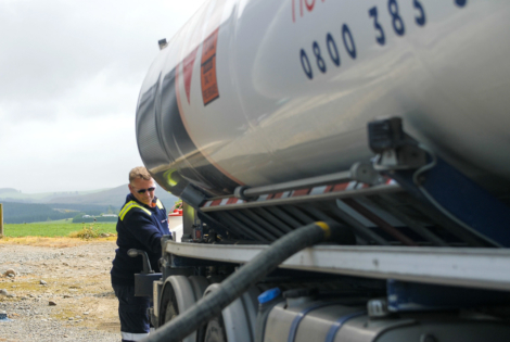 Allied driver delivering bulk fuel